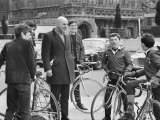 Actor Telly Savalas, Surrounded by Young Fans During a Walk in London with His Wife Photographic Print