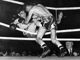 Boxing. Frankie Jones Pushes Opponent Malcolm Mclevel Out of the Ring Photographic Print