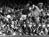 Arsenal Versus Nottingham Forrest, 1977. Kenny Burns Tackles Frank Stapleton Photographic Print