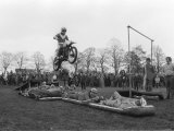 The Lionhearts - Eddie Kidd Takes Off over the Seven Brave Men Photographic Print