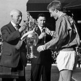 United Skipper Denis Law Receives the League Championship Trophy from League President Joe Richards Photographie