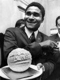 Holding a Football Made of Ice-Cream is Eusebio, at a London Reception. May 1968 Photographic Print