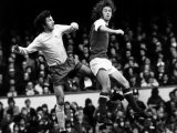 Football Player Charlie George Jumps with Roy Mcfarland For the Ball at Highbury Photographie