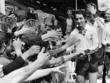 Osvaldo Ardiles Pulled to Shake Hands by the Local Spurs Fans at White Hart Lane Lámina fotográfica