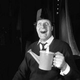 Tommy Cooper Comedian Wearing Fez Hat June 1965 and Holding Toy Watering Can Photographic Print