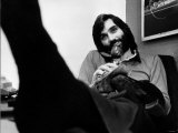 George Best in His Office Cleaning His Shoes Whilst Chatting on the Phone May 1974 Photographic Print