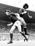 George Best of Manchester United Jumps For the Ball Against Alan Hunter of Ipswich at Old Trafford Photographic Print