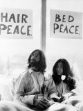 John Lennon and Wife Yoko Ono Having Weeks Love in Their Room at the Hilton Hotel, Amsterdam Photographic Print