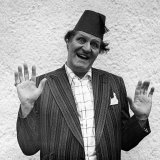 Comedian Tommy Cooper Wearing a Fez Hat 1975 Photographic Print