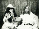 John Lennon and Yoko Ono at London Airport Presenting Acorns to Plant For Peace Photographic Print