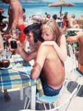 Footballer George Best with Actress and Model Susan George on Holiday in Palmanova, Majorca in 1969 Photographic Print