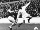 Billy Bonds of West Ham Challenges George Best of Manchester United at Upton Park Photographic Print