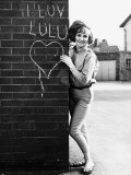Lulu Pop Singer Stands Besides Wall in 1964 Photographic Print