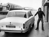 Manchester United Footballer George Best Arriving at Old Trafford For a Training Session Photographic Print