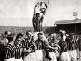 Manchester City Captain Roy Paul Holds Trophy Aloft as He Sits on the Shoulders of His Team Mates Photographic Print