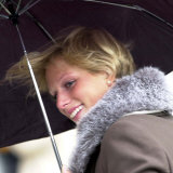 Zara Phillips Manages a Smile Despite the Weather at the Grand National, April 2001 Photographic Print