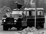 Queen Elizabeth II Looks on as Prince Edward Plays on the Roof of Their Land Rover Photographic Print