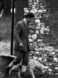 Prince Charles Walks a Dog at the Sandringham Shooting January 1981 Photographic Print