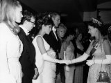 Raquel Welch Meets Queen Elizabeth in 1966 with Woody Allen and Ursula Andress Photographic Print