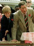 Prince Charles with Son Prince Harry Leaving Hand Prints in Concrete During Tour in South Africa Photographic Print