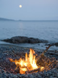Campfire on a Beach with a Full Moon Visible Photographic Print by Taylor S. Kennedy