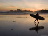 Surfer Walks Across the Beach at Sunset Photographic Print by Taylor S. Kennedy