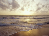 Warm Seas and Waves Roll onto a Tropical Island Beach at Sunset