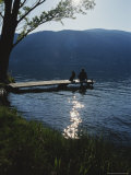 Man and His Dog on a Lake Skaha Dock Photographic Print by Mark Cosslett