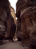 Hikers in the Siq Canyon Leading to Petra Photographic Print by Gordon Wiltsie