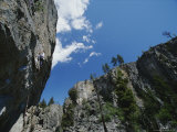 Climber Scales a Cliff in Skaha Bluffs Photographic Print by Mark Cosslett