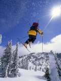 Skier in Mid Air at the Big Mountain Ski Area Photographic Print by Gordon Wiltsie