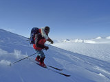 An Expedition Skier Descends Wind Blown Snow on Nemtinov Peak Photographic Print by Gordon Wiltsie
