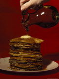Hand Pours Syrup onto a Stack of Pancakes Photographic Print by Brian Gordon Green