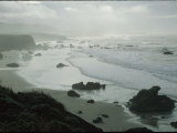 Waves Wash Ashore on a Fog-Shrouded San Simeon Beach Photographic Print by Marc Moritsch