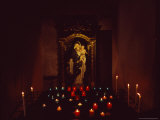 Statue of a Madonna and Child with Votive Candles in a Church Photographic Print by David Evans