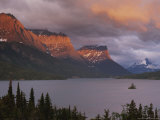Dawn Strikes the Mountains Rising Above St. Mary Lake Photographic Print by Raymond Gehman
