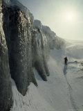 Skier on a Frozen Fjord Beneath Ice Cliffs of Nordenskjold Glacier Photographic Print by Gordon Wiltsie