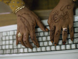 Woman's Hands on a Computer Keyboard Decorated with Henna Photographic Print by Lynn Abercrombie