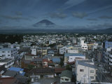 Mt. Fuji Looms on the Distant Horizon Beyond a Japanese Town Photographic Print by Karen Kasmauski
