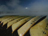 Canoes are Stacked Together on a Lakeshore Photographic Print by Karen Kasmauski