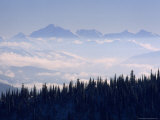 Clouds Envelope the Rocky Mountains Near Whitefish Photographic Print by Gordon Wiltsie