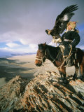 Hunter on Horseback Atop a Hill Holding a Golden Eagle in Mongolia Photographic Print by David Edwards