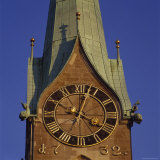 The Clock Face and Leaping Fish Sculptures on Fraumunster Cathedral Photographic Print by David Pluth