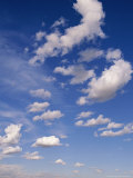 Cumulus Clouds Above the Masai Mara National Reserve Photographic Print by John Eastcott & Yva Momatiuk