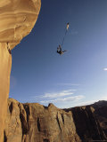 Base Jumper Leaping with a Parachute From the Tombstone Formation Photographic Print by Jimmy Chin