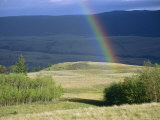 Rainbow Touches Down on a Plain After an Evening Rainstorm Photographic Print by Raymond Gehman