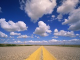Cumulus Clouds in Blue Summer Sky Over Paved Road Photographic Print by John Eastcott & Yva Momatiuk