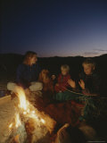 The Wiltsie Family Enjoys a Campfire During a Winter Camping Trip Photographic Print by Gordon Wiltsie