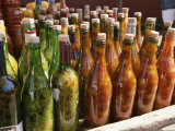 Close View of a Colorful Group of Bottles Containing Foodstuffs Photographic Print by Ed George