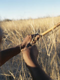 San Bushman Hunts with a Bow and Arrow Photographic Print by Joy Tessman